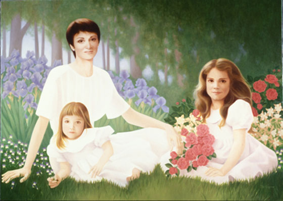family portrait of mother and two daughters in the garden